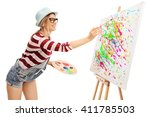 Young Woman Painting On A...