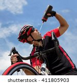 cyclist drinking from a bottle... | Shutterstock . vector #411805903