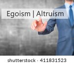 Small photo of Altruism Egoism - Businessman hand pressing button on touch screen interface. Business, technology, internet concept.
