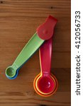 A Red Measuring Spoon With The...