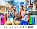 family eating ice cream in... | Shutterstock . vector #412165207