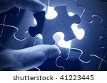 hands placing last piece of a... | Shutterstock . vector #41223445