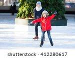Little Boy Learning Ice Skatin...
