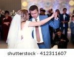 happy beautiful newlyweds dance ... | Shutterstock . vector #412311607
