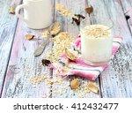 oat milk in a glass on the...   Shutterstock . vector #412432477