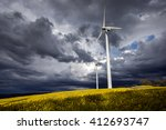 Wind Turbines And Flower Field...