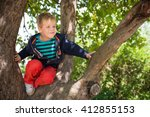 Cute Little Boy Sitting On The...