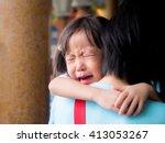 asian baby girl hugging her... | Shutterstock . vector #413053267