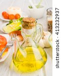 glass oil with olive oil on wood | Shutterstock . vector #413232937