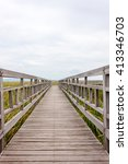 Small photo of Wooden bridge in lotus lake name Bung Bua at Khao sam roi yod national park, Thailand. In cloudy day