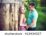 happy couple smiling at the... | Shutterstock . vector #413434327