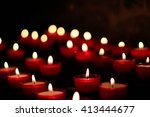 Small Red Burning Candles In...