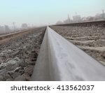 Small photo of The rails, stretching to the horizon, photographed by a camera, placed on the rail head