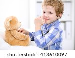 doctor examining a child ... | Shutterstock . vector #413610097