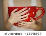 woman hands holding giant... | Shutterstock . vector #413646937