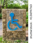 handicap sign on stone slab | Shutterstock . vector #413694763