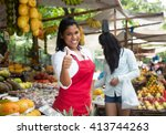 laughing mexican saleswoman... | Shutterstock . vector #413744263