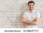 handsome young man is pointing... | Shutterstock . vector #413869717