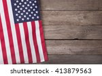 Small photo of United States of America flag on a wooden background