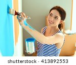 Happy Smiling Woman Painting...