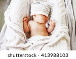 a little baby lies in the crib. | Shutterstock . vector #413988103
