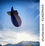 Small photo of ROTTACH, GERMANY - FEB 27: blimp (hot air airship) starting at the european alps on feb 27, 2016 in rottach, germany
