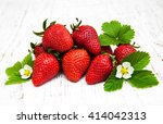 Strawberries  With Leaves On A...