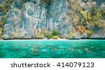 tourists enjoy with snorkeling... | Shutterstock . vector #414079123