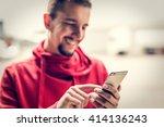 man using smartphone. | Shutterstock . vector #414136243