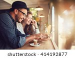 smiling young couple in a... | Shutterstock . vector #414192877