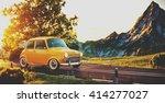 cute little retro car goes by... | Shutterstock . vector #414277027