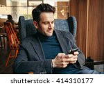 young businessman texting on a... | Shutterstock . vector #414310177