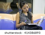 woman sitting in the subway car ... | Shutterstock . vector #414386893