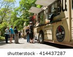 Small photo of ATLANTA, GA - APRIL 16: People stand in line to buy meals from a food truck lined up in Grant Park at the Food-o-rama festival on April 16, 2016 in Atlanta, GA.