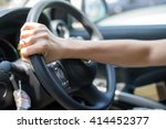 driving  hand grab on the wheel. | Shutterstock . vector #414452377