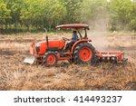 Farmer Plowing Stubble Field...