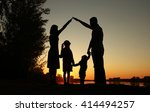 a silhouette of a happy family... | Shutterstock . vector #414494257