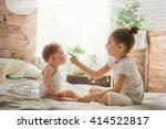 two cute child baby girls... | Shutterstock . vector #414522817
