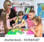 happy children with teacher... | Shutterstock . vector #414564187