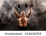 bald topless muscular man doing ... | Shutterstock . vector #414636553