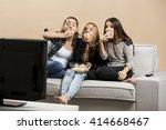 teenage girls watching horror... | Shutterstock . vector #414668467