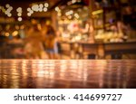 Small photo of Real wood table with light reflection on scene at restaurant, pub or bar at night. Blurred background for product display or montage your products with several concept idea and any occasional.