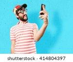 fool crazy man. happy expression | Shutterstock . vector #414804397