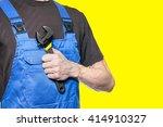 man mechanic in working clothes ... | Shutterstock . vector #414910327