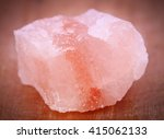 Small photo of Saindhava lavana or Himalayan Pink rock salt on wooden surface