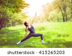 young woman doing yoga in... | Shutterstock . vector #415265203