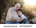 Grandfather Hugging His Grandson