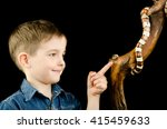 little boy and king snake | Shutterstock . vector #415459633
