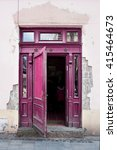 Small photo of Vintage ajar pink (magenta) door.