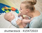 mother with infant boy | Shutterstock . vector #415472023